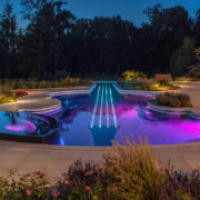 interesting-design-exterior-landscape-lighting-ideas-violin-shape-swimming-pool-blue-purple-colors-led-lights-under-water-stone-walkway-upper-lights-garden-lamps-pretty-garden-exterior-landscape-ligh