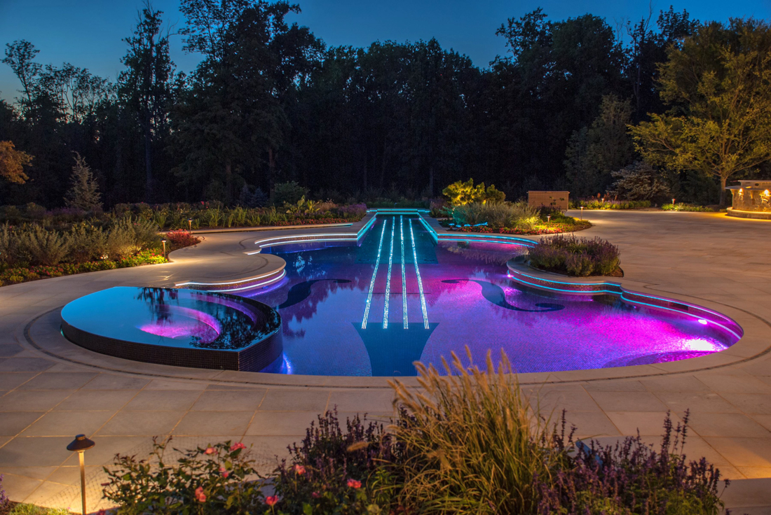 interesting-design-exterior-landscape-lighting-ideas-violin-shape-swimming-pool-blue-purple-colors-led-lights-under-water-stone-walkway-upper-lights-garden-lamps-pretty-garden-exterior-landscape-ligh
